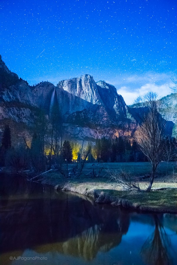 Yosemite Falls reflecting in the Mercedes River at night